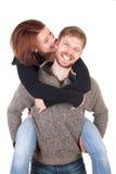 Glückliche junge Paare - Frau, die liebevoll Mann beißt Stockfotografie