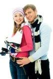 Glückliche junge Paare gehender Eis-Eislauf Stockfoto