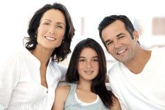 Glückliche kaukasische Familie mit einem Kind Lizenzfreie Stockfotos