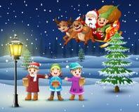 Glückliche Kinder, die im schneienden Dorf mit Sankt-flyng über ihnen singen stock abbildung