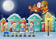 Glückliche Kinder, die im schneienden Dorf mit Sankt-flyng singen stock abbildung