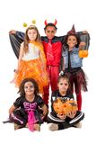 Glückliche Kinder in Halloween Stockfotos