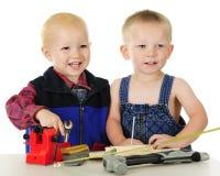 Glückliche Kleinkind-Werkzeug-Männer Lizenzfreie Stockbilder