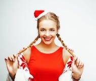 Glückliche lächelnde blonde Frau der Junge recht auf Weihnachten in rotem Hut und in Feiertag Sankt verzierte Plaid, Lebensstille Stockbild
