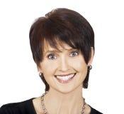 Glückliche lächelnde mittlere gealterte Frau lizenzfreie stockbilder