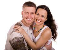 Glückliche lächelnde Paare lizenzfreie stockbilder