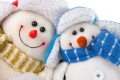Glückliche lächelnde Schneemannpaare Stockfoto