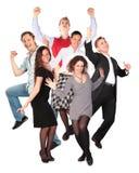Glückliche lächelnde springende Gruppe Stockfotografie