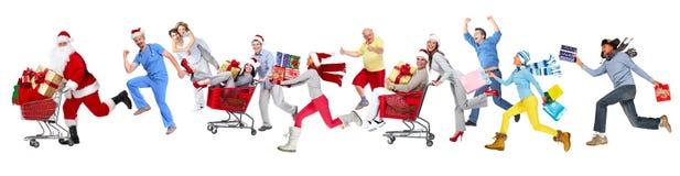 Glückliche laufende Weihnachtsleute stockfoto