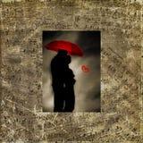 Glückliche liebevolle Paare auf einem weißen Hintergrund lizenzfreies stockbild