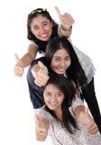 3 glückliche Mädchendaumen oben stockbild