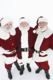 Glückliche Männer in Santa Claus Outfits Standing Together Lizenzfreie Stockfotos
