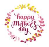 Glückliche Mother's-Tageshandbeschriftung in einem Kranz Stockbilder