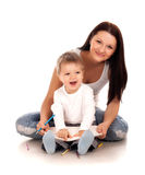 Glückliche Mutter mit einem Kind Stockbilder