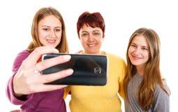 Glückliche Mutter mit Töchtern Stockfotos