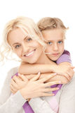Glückliche Mutter und kleines Mädchen Stockfotos