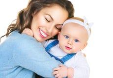 Glückliche Mutter und und kleine Tochter Lizenzfreies Stockfoto