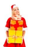 Glückliche nachdenkliche weibliche Sankt mit Weihnachtsgeschenken Lizenzfreie Stockfotografie