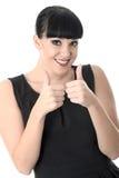 Glückliche nette erfreute positive Frau mit den Daumen oben Stockfotos