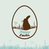 Glückliche Ostern-Karte mit Kaninchen in Form des Eies Stockfotografie