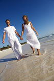 Glückliche Paare auf Strand Lizenzfreies Stockbild