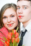 Glückliche Paare mit Tulpen Stockfotos