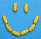 Glückliche Pillen Stockbilder