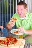 Glückliche Pizza Stockfotos