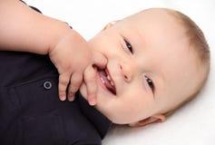 Glückliche Rückseite des Babys an Stockfoto