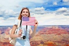 Glückliche Reisefrau in Amerika Stockfotografie