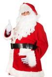 Glückliche Santa Claus, die sich Daumen zeigt lizenzfreies stockbild