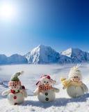 Glückliche Schneemannfreunde Stockfoto