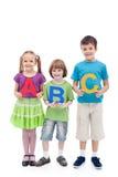 Glückliche Schule scherzt große ABC-Zeichen der Holding Lizenzfreies Stockbild