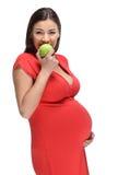 Glückliche schwangere Frau mit Apfel Lizenzfreie Stockfotos