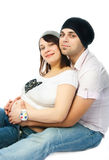 Glückliche schwangere Frau und ihr Ehemann stockfotos