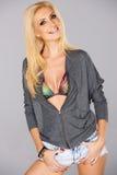 Glückliche sexy blonde Frauenaufstellung Stockbild