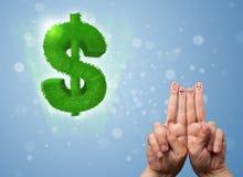 Glückliche smileyfinger, die grünes Blattdollarzeichen betrachten Lizenzfreie Stockfotos