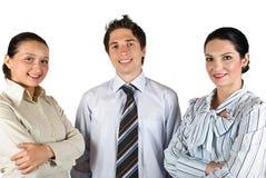 Glückliche Teamarbeit der jungen Leute Stockbilder