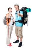 Glückliche Touristen mit Flaschen Wasser auf einem Weiß Stockfotografie