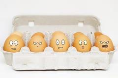 Glückliche und verärgerte Eier Lizenzfreies Stockfoto
