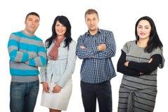 Glückliche vier mittlere Erwachsenfreunde Stockfotos