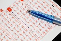 Glückliche Zahl auf der Lotterie lizenzfreie stockfotos