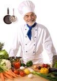 Glücklicher attraktiver Koch lizenzfreie stockfotos