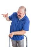 Glücklicher bärtiger Guy Pointing Someone auf dem links Stockfotografie