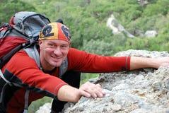 Glücklicher Bergsteiger Stockbild