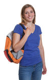 Glücklicher blonder Student mit Rucksack Lizenzfreies Stockbild