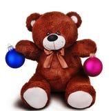 Glücklicher brauner Teddybär mit Weihnachtsspielwaren Lizenzfreie Stockbilder