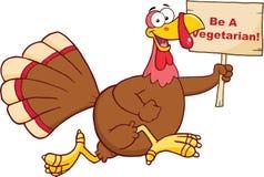 Glücklicher die Türkei-Vogel-Charakter, der mit einem leeren hölzernen Zeichen läuft Lizenzfreie Stockfotografie