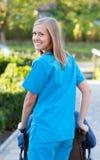 Glücklicher Doktor mit Patienten Stockfoto