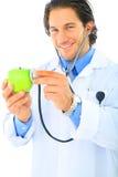 Glücklicher Doktor Promoting Healthy Eating Lizenzfreie Stockfotografie